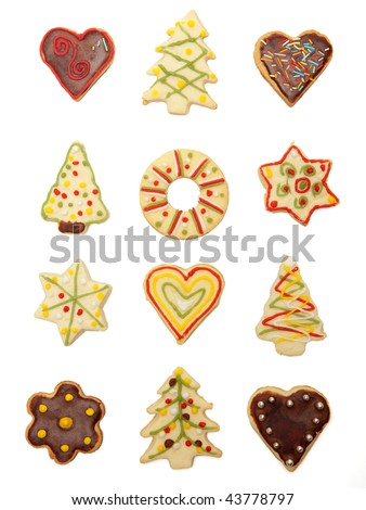 Collection of various handmade christmas cookies, covered and decorated with chocolate and colorful sugar
