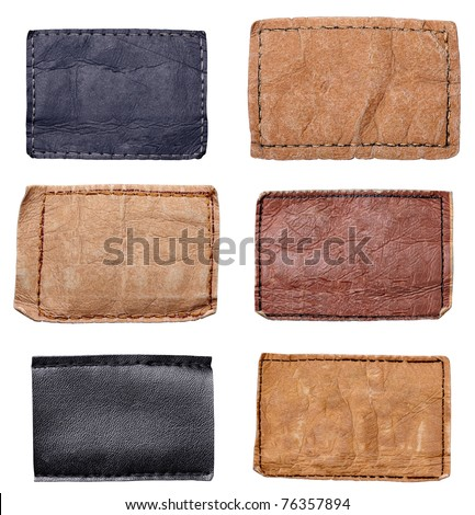 collection of various jeans labels on white background. each one is shot separately