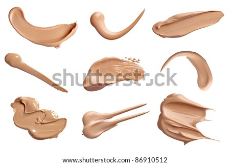 collection of various make up liquid powder strokes on white background. each one is shot separately