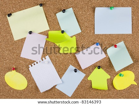 collection of various note papers on an corkboard
