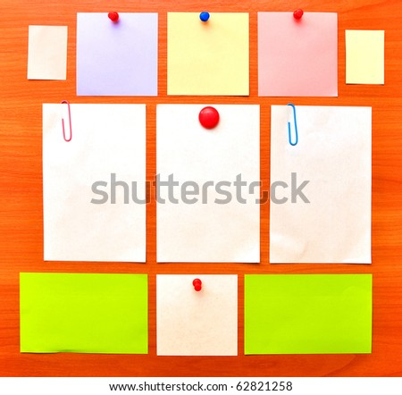 collection of various note papers on wood background