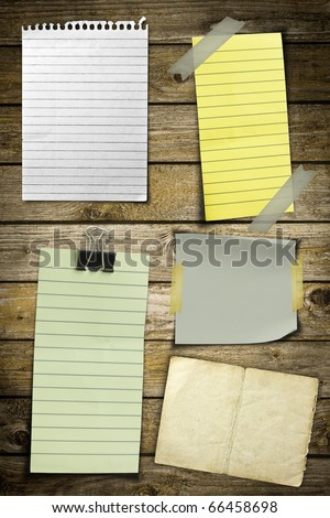 Collection of various note papers on wooden background