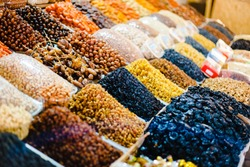 Collection of various raisins. Dry fruit mix on food market, colorful dry fruits, dried fruits, different types of dry fruits, Assortment of dried fruits at market. At Odessa Privoz market, Ukraine