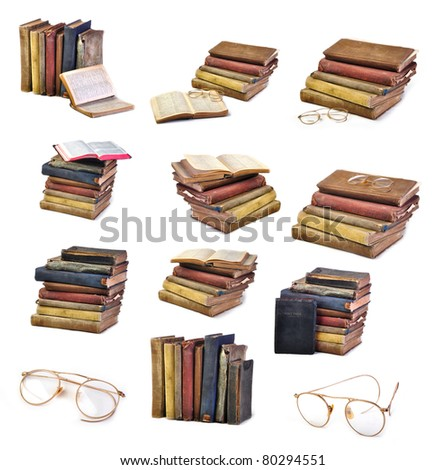 Collection of Vintage antique books and glasses isolated on white