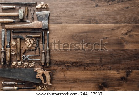 Collection of vintage woodworking tools on a rough workbench and blank copy space, carpentry, craftsmanship and handwork concept, flat lay