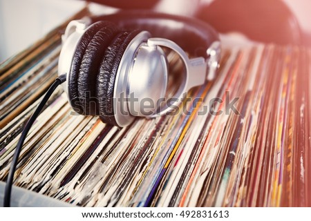 Collection of vinyl records for DJ, music lover, hipster. Listen to analog record in headphones. Analog audio equipment.Head phones for disc jockey