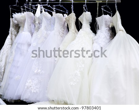 Collection of wedding dresses in the shop - stock photo