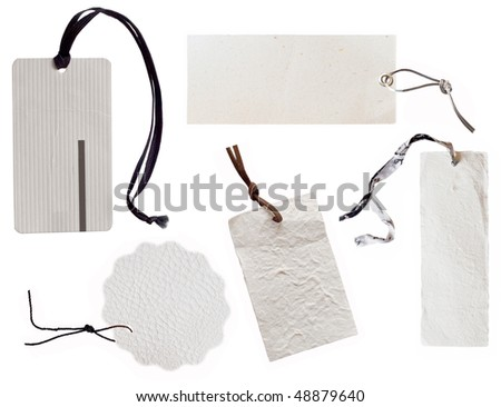 collection of white tags with dark string
