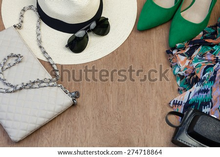 Collection of woman\'s summer essential accessories, overhead shoot