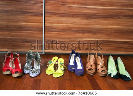 collection of woman shoes on the floor