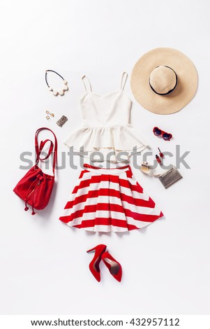 Shutterstock collection of women's clothing and accessories. Overhead of essentials young woman. Outfit of casual and elegant woman, red shoes, summer hat, handbag, high heels shoes, sunglasses.