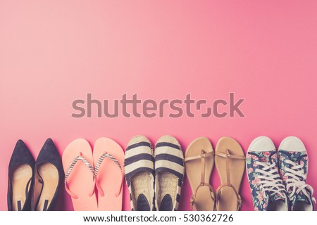 Collection of women's shoes on pink background #530362726