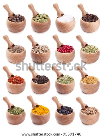 collection of wooden bowls full of different spices with scoops in it
