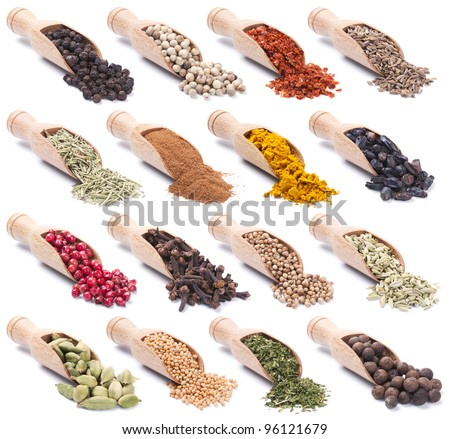 Collection of wooden shovels with spices and herbs