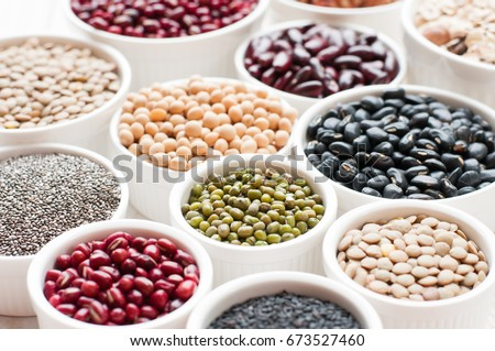 collection set of beans, legumes, peas, lentils on ceramic bowl on white wooden background #673527460