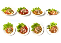 Collection set of Spicy salad (Yum Thai style) Traditional spicy -hot seafood, egg Thai food. Thai cuisine delicious food popular of Thailand decorate of vegetable salad Isolated on white background