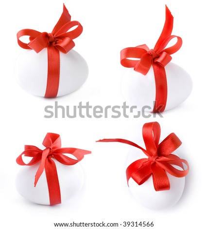Collection set of White egg wrapped around with red ribbon isolate over white background