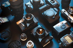 Collection Vintage Film And Digital Cameras, On Black Background, Top View