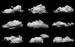 Collections of separate white clouds on a black background have real clouds. White cloud isolated on a black background realistic cloud. white fluffy cumulus cloud isolated cutout on black background.