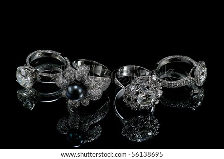 Collectionsof rings with diamond isolated on black background