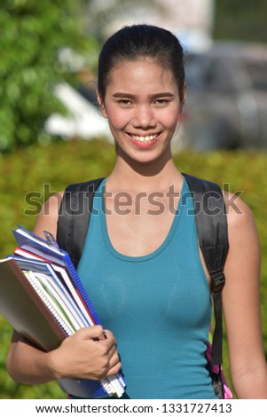 College Asian Student Portrait With Books