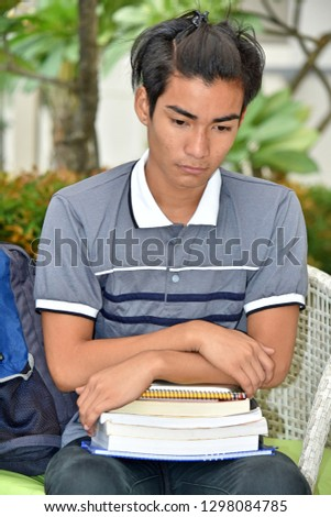 College Diverse Male Student Alone With Notebooks