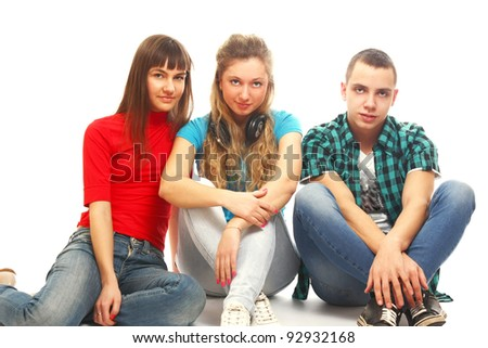 College friends sitting on the floor, isolated on white background