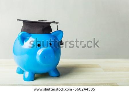 College graduate student diploma piggy bank #560244385