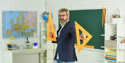 College high school. Prepare for test. Teacher bearded man chalkboard background. Teacher work. Lecturer in classroom. Final examination may be oral written or practical. Teacher explaining theory.