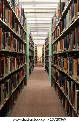 college library book stacks with bookshelves full of books