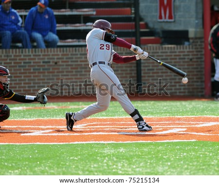 COLLEGE PARK, MD - APRIL 2: Florida State University catcher Rafael Lopez swings at a pitch and tips it off the end of the bat during a game against Maryland April 2, 2011 in College Park, MD.