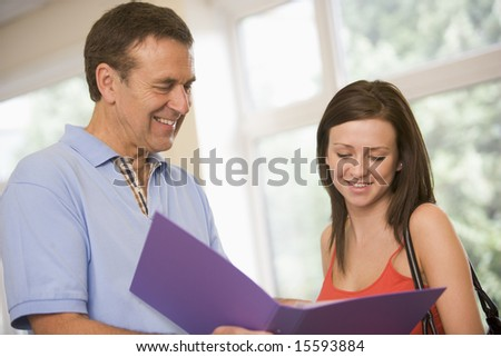 College professor providing guidance to a female student
