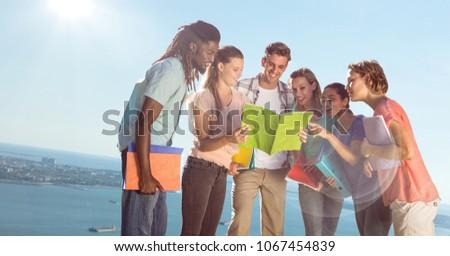 College students against blurry slanted coastline #1067454839