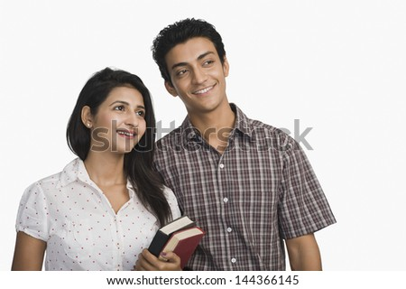 College students holding books and smiling Photo stock ©
