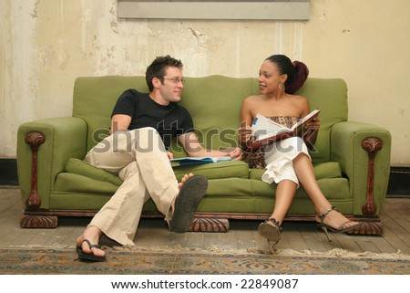 College students in poverty housing studying. - stock photo