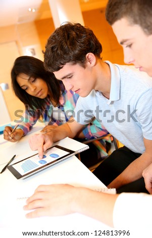 College students in training class with tablet