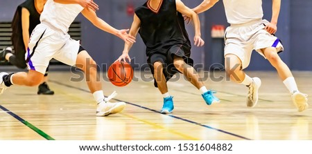 College students playing basketball games at the gymnasium Stock photo ©