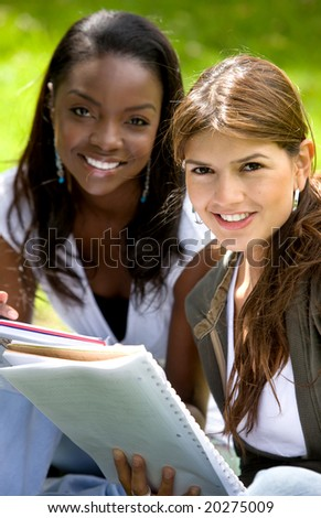 college students smiling outdoors looking very happy
