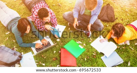 college students using laptop...