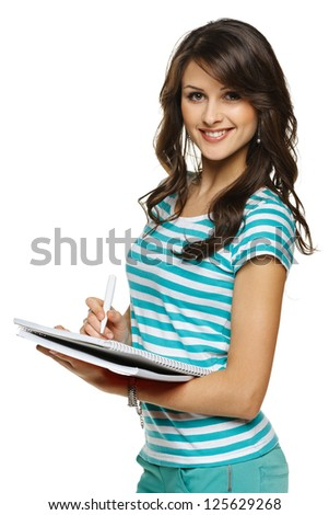 College university student woman making notes in the notebook, over white background