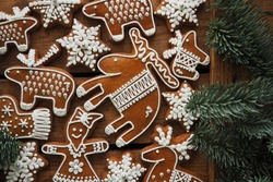 Collektion of Christmasgingerbread  cookies  on wooden background  Snowflakes, elk, reindeer, christmastree. Homemade delicious Flat lay, chritmas festive background. Xmas creative Greeting Card