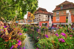 Colmar city - Petite Scenic view on water canal and traditional half timbered houses at sunrise, Alsace, France