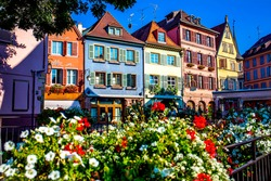 COLMAR, FRANCE - AUGUST 25, 2019 :: Landscape of half-timbered houses and shops in downtown of old town Colmar. A famous destination for traveller in France.