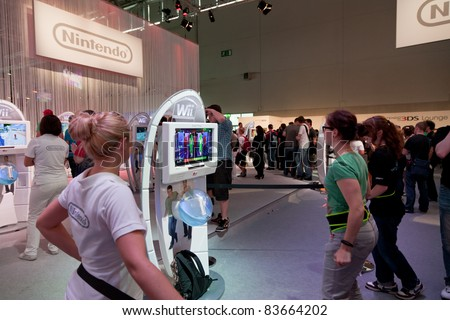 COLOGNE - AUGUST 20: Female Videogamers playing with Nintendo Wii and Just Dance 3 at GamesCom 2011, the most important European video games Expo August 20, 2011 in Cologne, DE