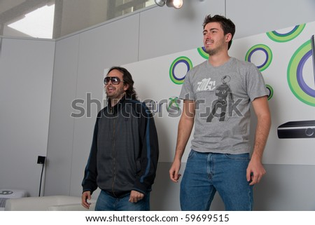 COLOGNE - AUGUST 18: Kudo Tsunoda (on left), creative director, showcasing Kinect videogames for Xbox 360 at GamesCom 2010, the most important European video games Expo August 18, 2010 in Cologne, DE