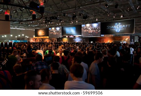 COLOGNE - AUGUST 21: Thousand visitors gathering at Blizzard Booth at GamesCom 2010, the most important European video games Expo August 21, 2010 in Cologne, DE
