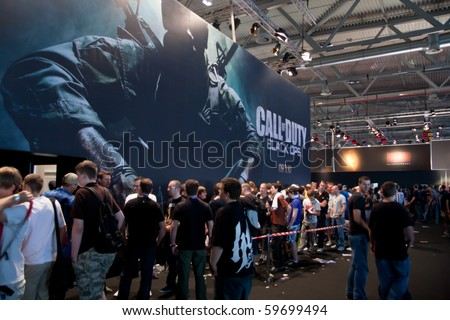 COLOGNE - AUGUST 21: Videogamers getting in line to play Call of Duty: Back Ops at GamesCom 2010, the most important European video games Expo August 21, 2010 in Cologne, DE
