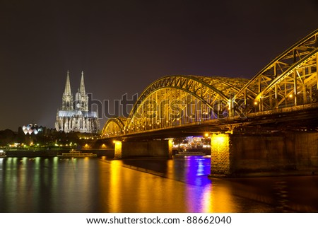 Cologne Cathedral and Hohenzollern Bridge at night, Cologne (Köln), Germany