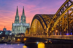 Cologne Cathedral and Hohenzollern Bridge at sunset / nighttime