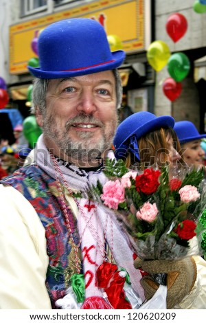 COLOGNE, GERMANY - FEBRUARY 27: Unidentified people in the Carnival parade on February 27, 2006 in Cologne, Germany. This parade is organized yearly.